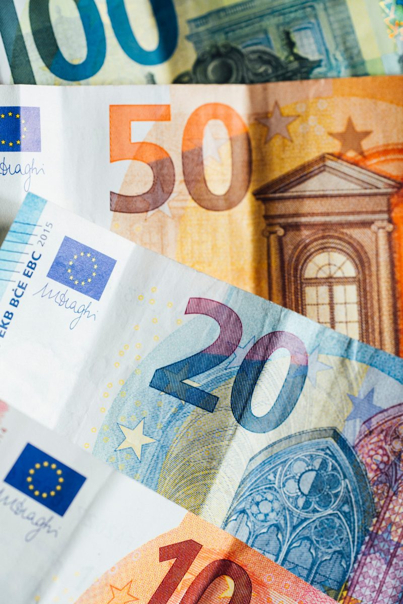 20 euro bill on brown wooden table